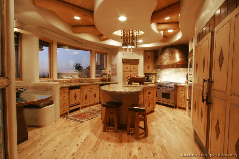 Rustic Santa Fe Style Kitchen with Adobe Walls, Inlaid Cabinets, and Log Ceiling Beams
