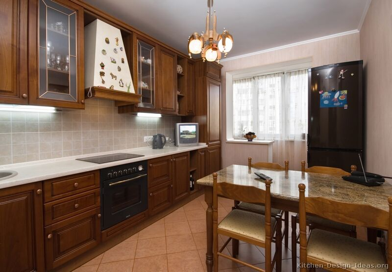 Pictures of kitchens traditional medium wood cabinets for What is traditional kitchen