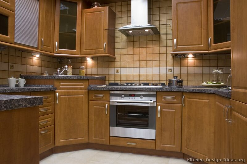 Pictures of kitchens traditional medium wood cabinets for Corner sink kitchen design ideas