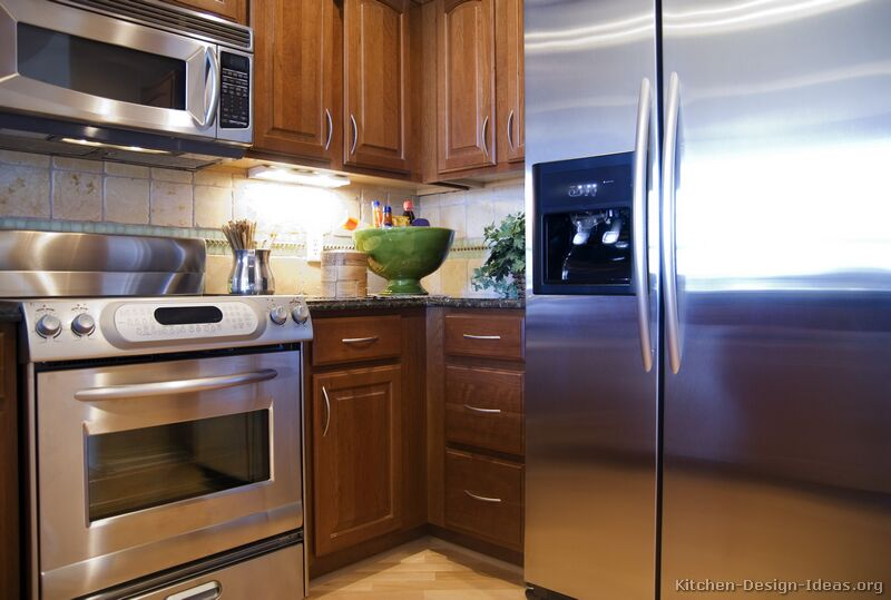 Pictures of kitchens traditional medium wood cabinets for Traditional kitchen appliances