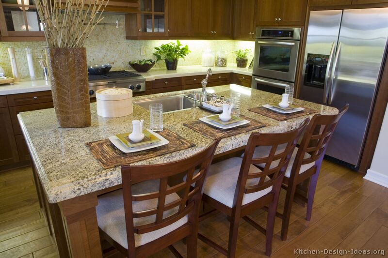 Pictures of kitchens traditional medium wood cabinets - Kitchen island with sink and dishwasher and seating ...
