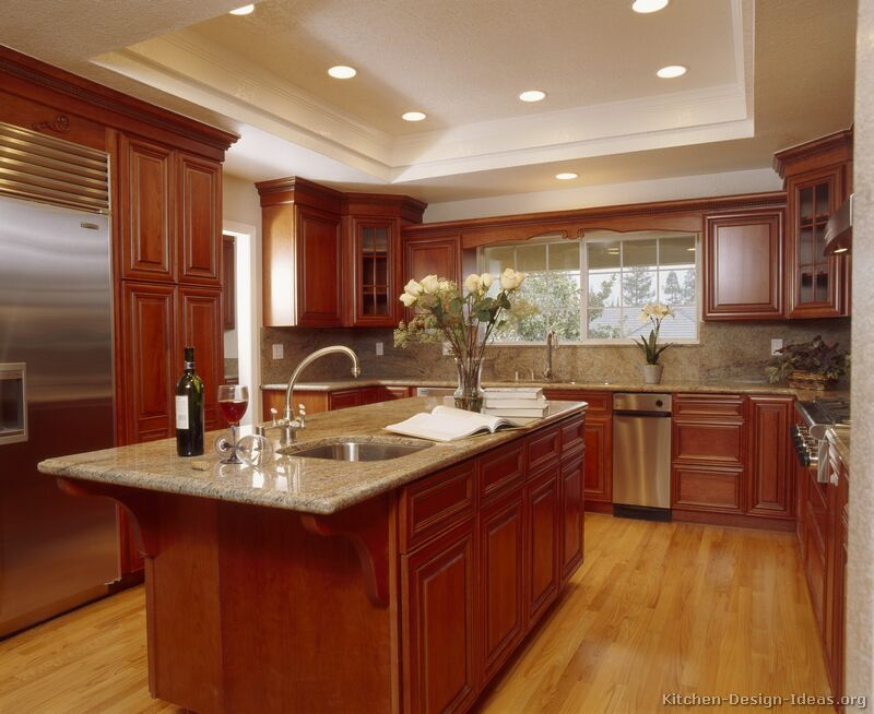 Kitchens Featuring Medium Cherry Colored Wood Cabinets In Traditional
