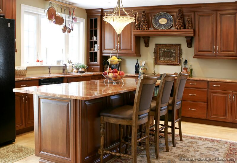 Pictures of kitchens traditional medium wood kitchens for Kitchen island table with chairs