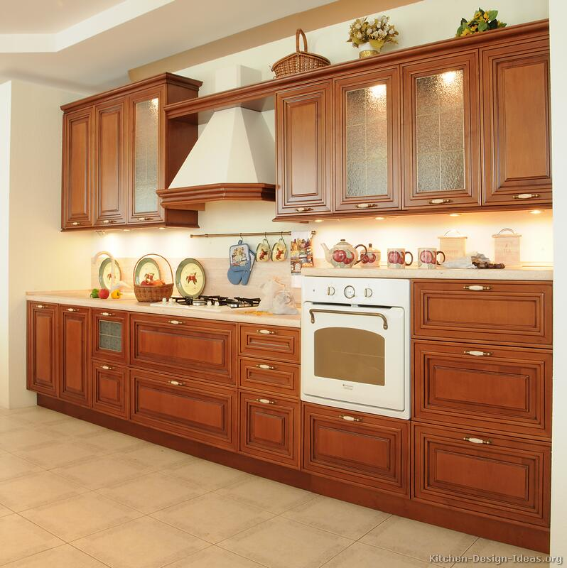 Pictures of kitchens traditional medium wood cherry for Wooden kitchen cupboards