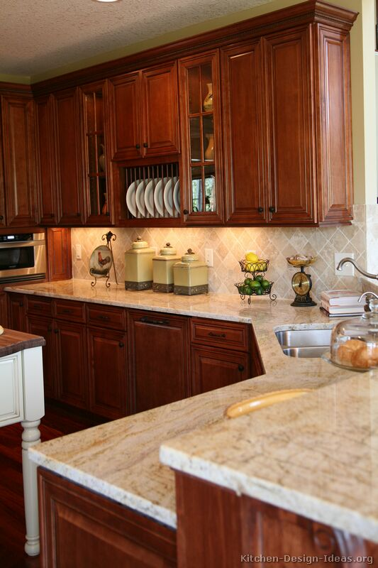 Pictures of kitchens traditional medium wood kitchens for Kitchen cabinets and countertops ideas
