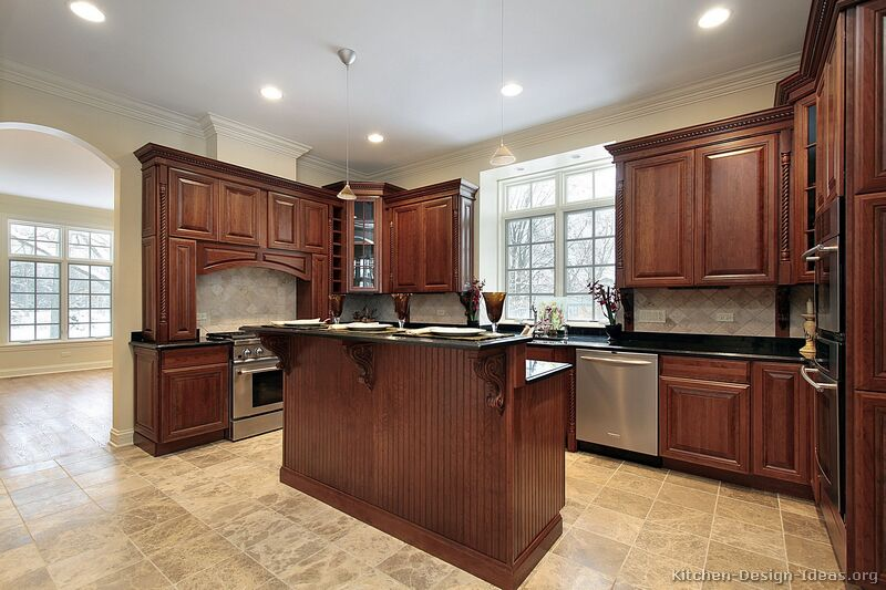 Pictures of kitchens traditional medium wood kitchens for Kitchen paint colors with dark wood cabinets