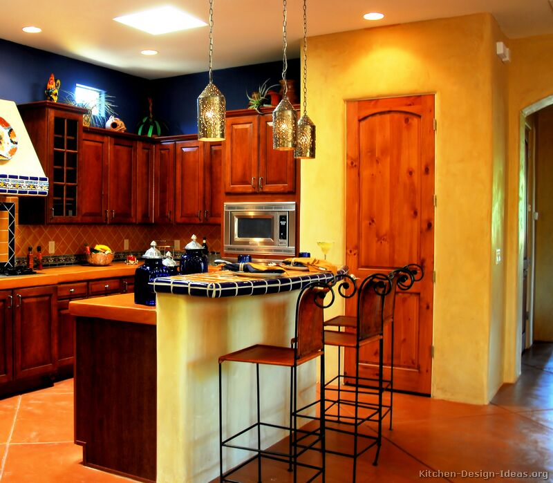 Yellow And Blue Kitchen Ideas Part - 32: A Bold U0026 Spicy Mexican Kitchen With Golden Adobe Walls, Rich Wood Cabinets,  Blue Accents, A Combination Of Tile And Concrete Countertops, ...