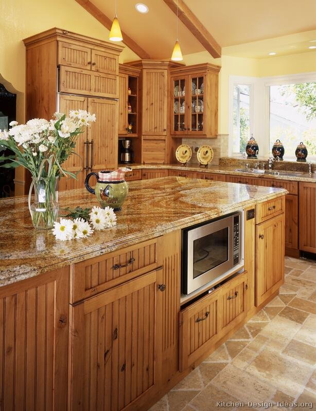 A large country kitchen with knotty alder cabinets for Country kitchen cabinets