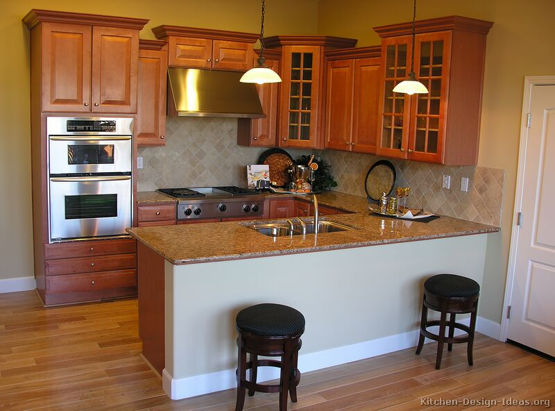 Pictures of kitchens traditional medium wood golden for Peninsula kitchen designs