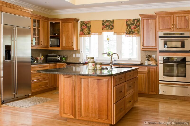 Pictures of kitchens traditional medium wood golden for Kitchen remodel oak cabinets