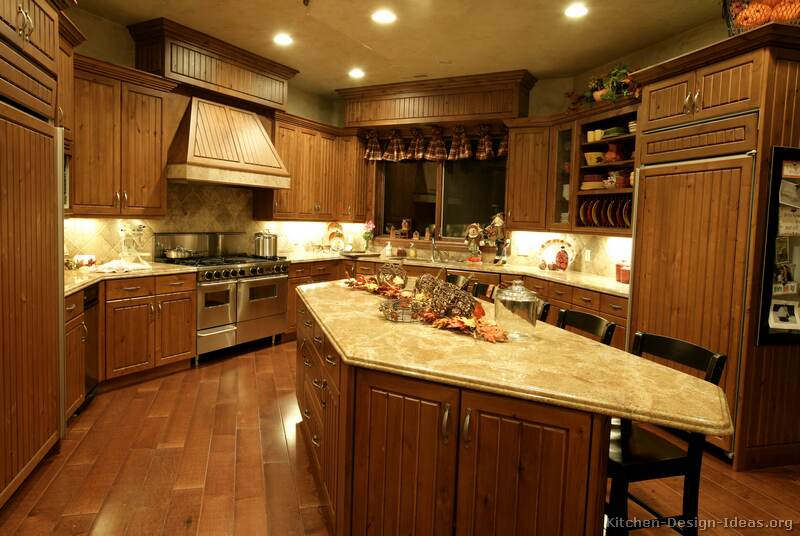 Pictures of kitchens traditional medium wood golden for Kitchen ideas brown cabinets
