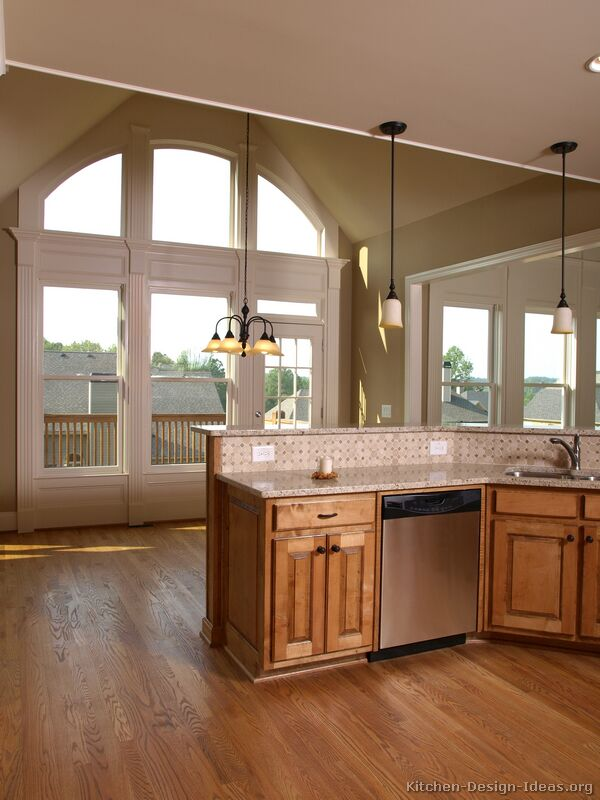 Pictures of kitchens traditional medium wood golden for Medium kitchen designs