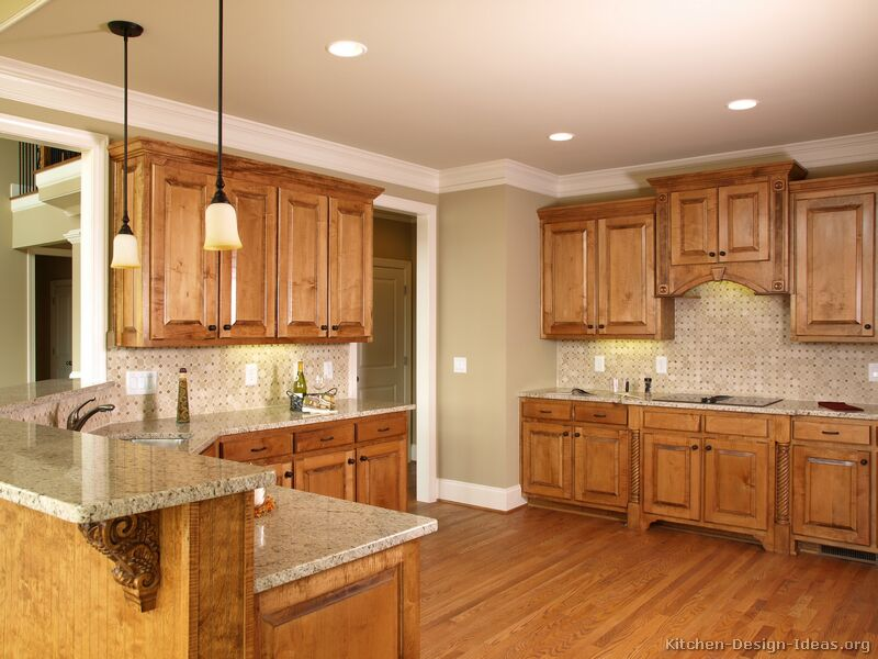 Pictures of kitchens traditional medium wood cabinets for Kitchen paint colors with dark wood cabinets