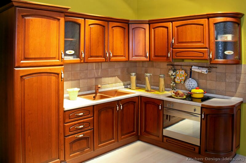 Pictures of kitchens traditional medium wood cabinets for Wooden kitchen cupboards