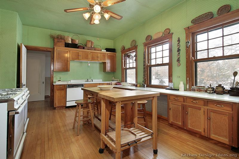 Pictures of kitchens traditional medium wood cabinets for Kitchen paint colors green