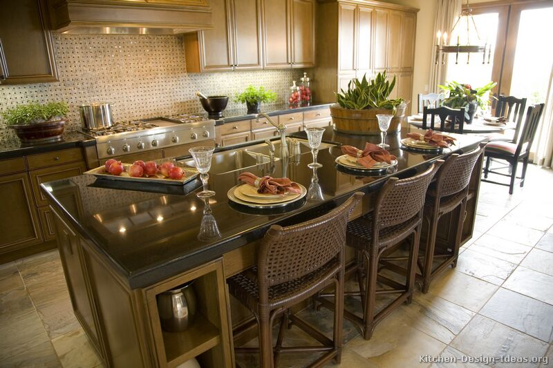 has pictures of kitchens featuring medium olive colored wood cabinets