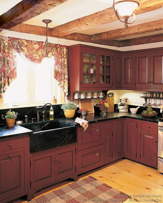 A rustic country kitchen in the early american style for Dark red kitchen cabinets