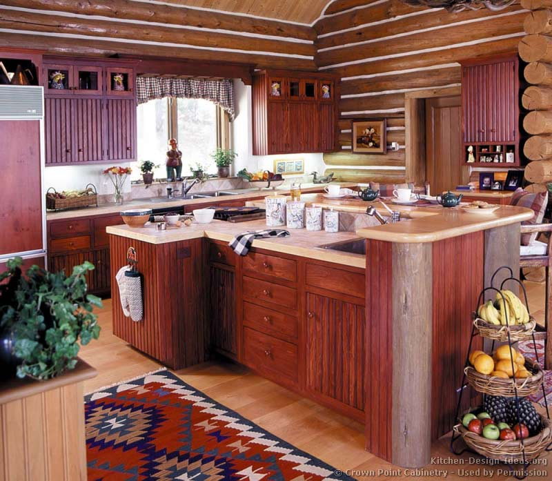 Log Home Kitchen with Red Cabinets and Vaulted Ceilings