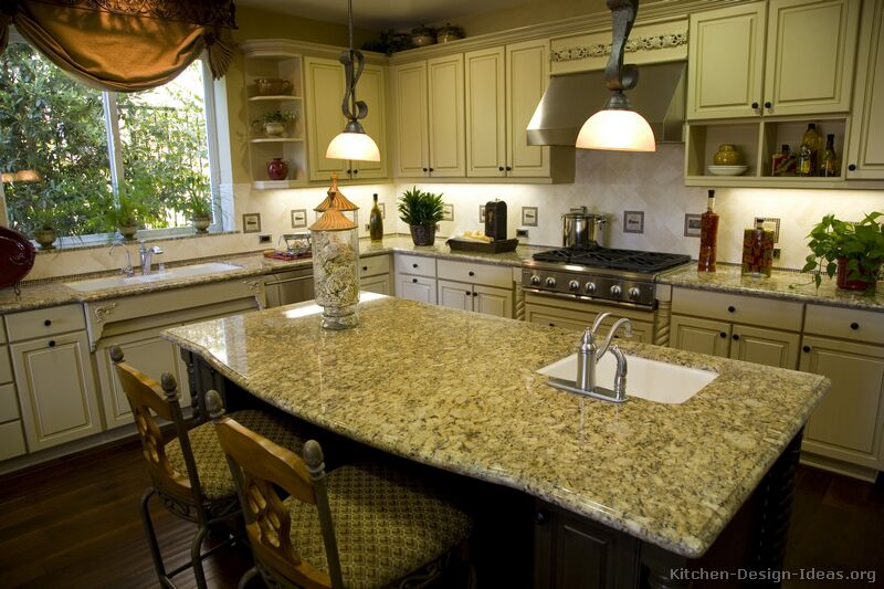 Pictures of kitchens traditional two tone kitchen cabinets for Antique white kitchen cabinets with dark island