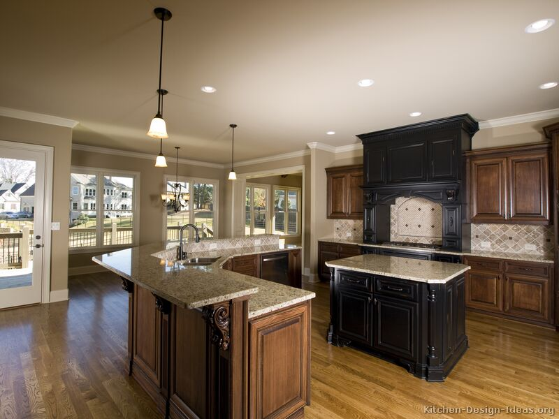 Pictures of kitchens traditional two tone kitchen cabinets for Dark kitchen cabinets light island