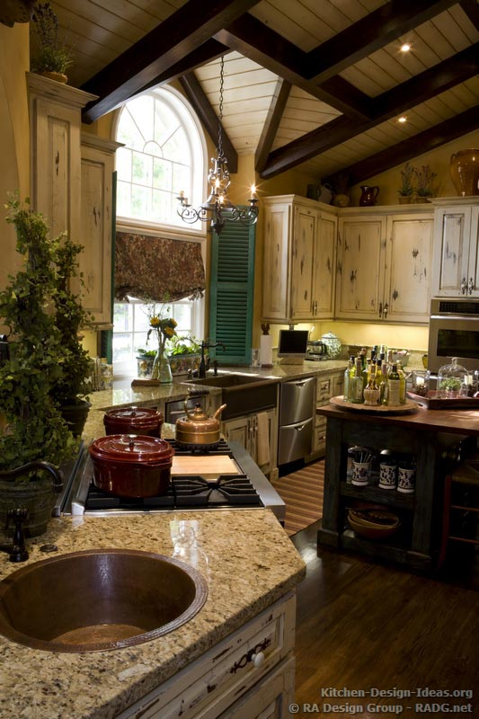 Country french kitchen cabinets with an antique white French country kitchen decor