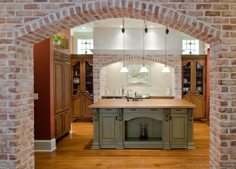 Old World Kitchen With Brick Arches And Antique Cabinets
