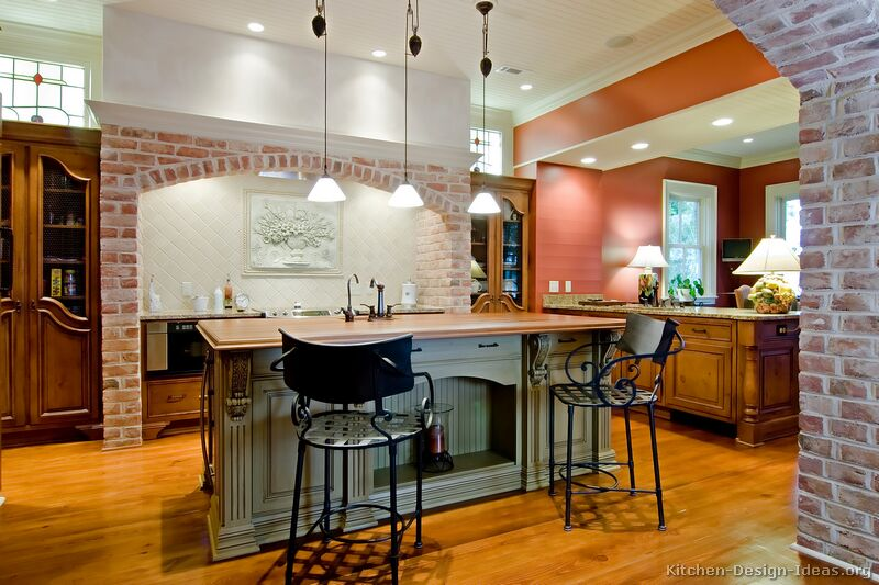 Wrought iron bar stools with woven seats in an old world kitchen