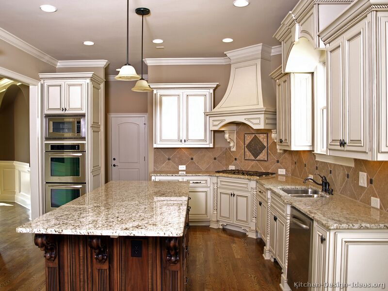 Pictures of kitchens traditional two tone kitchen for Kitchen designs with white cabinets