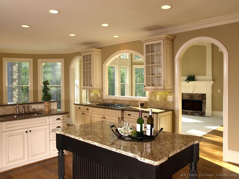 Pictures of kitchens traditional off white antique for Kitchen wall colors with white cabinets
