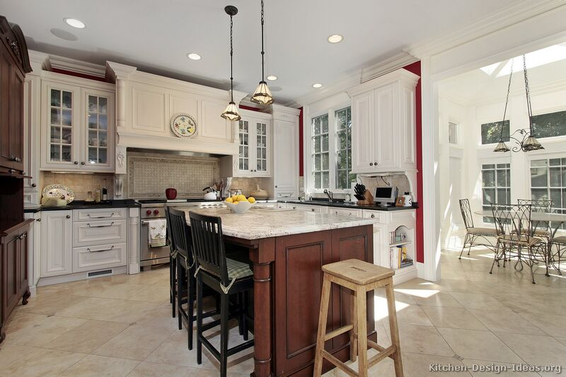 A Traditional White Kitchen with a Dark Cherry Island