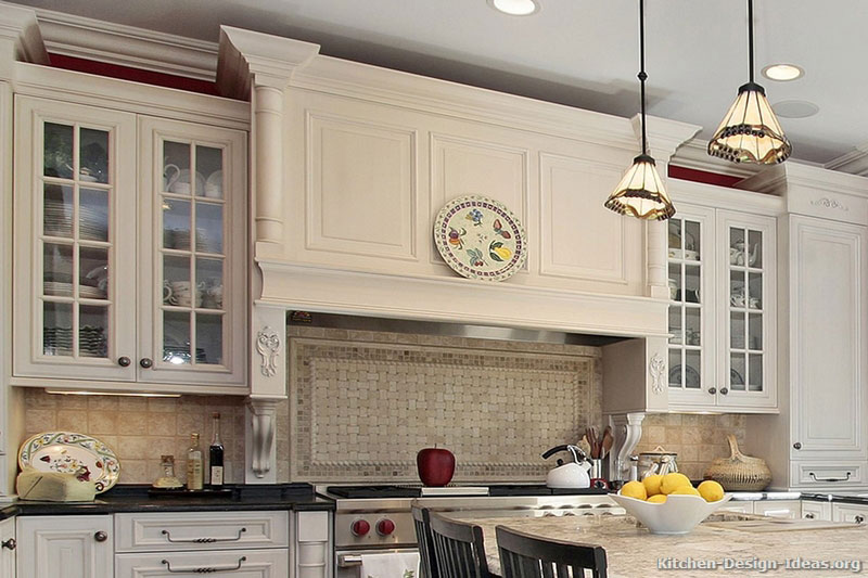 Mantel Style Range Hood, Basketweave Backsplash, and Mullion Glass Door Cabinets