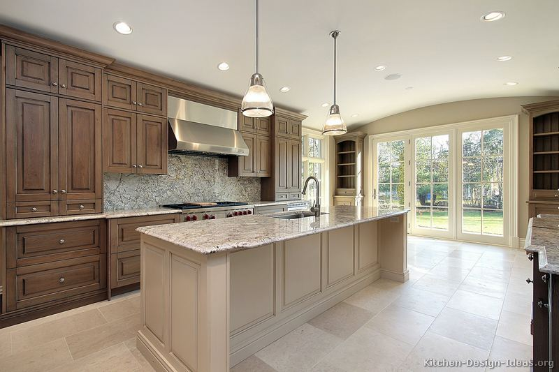 Pictures of kitchens traditional medium wood cabinets for Antique white kitchen cabinets with dark island