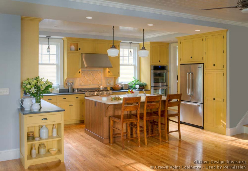 Pictures of kitchens traditional yellow kitchen cabinets for Blue kitchen cabinets with yellow walls