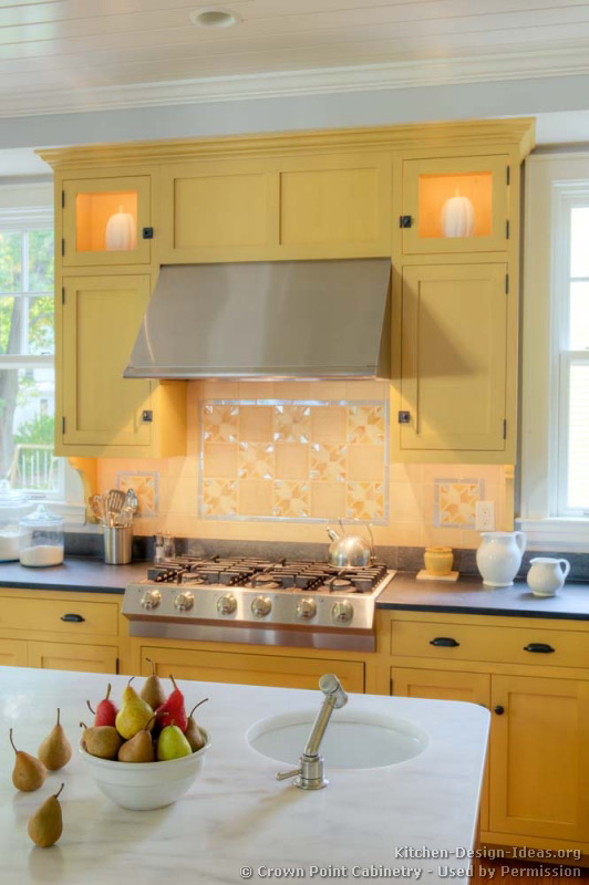 Kitchen Backsplash Yellow traditional yellow kitchen with a custom wood island