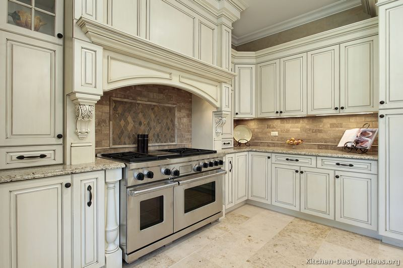 Pictures of kitchens traditional two tone kitchen for Armoire cuisine antique