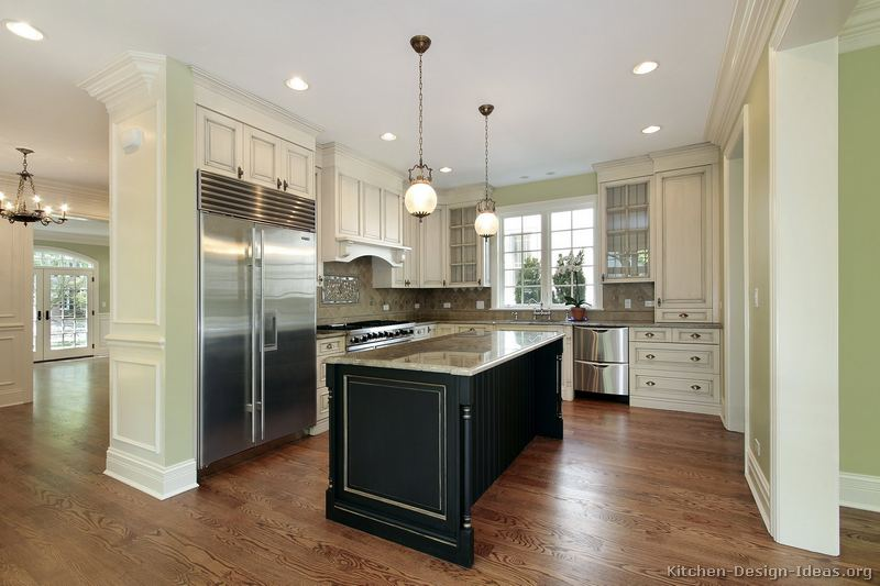 Pictures of kitchens traditional two tone kitchen for Black and white kitchen cabinet designs