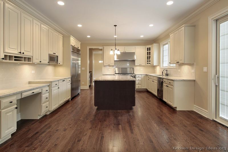 Pictures of kitchens traditional two tone kitchen for White kitchen cabinets with hardwood floors