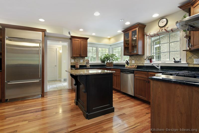 Kitchen With Half White Cabinets And Half Black Cabinets On Dark Wood Floor With White photo - 1