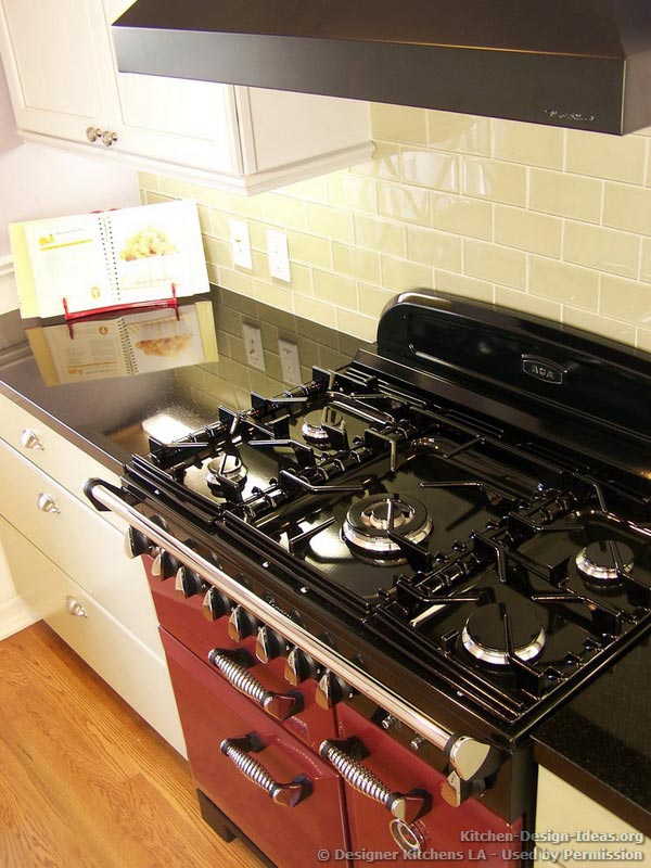 A Glossy Red AGA Range Oven with a Black Cooktop and Classic Styling