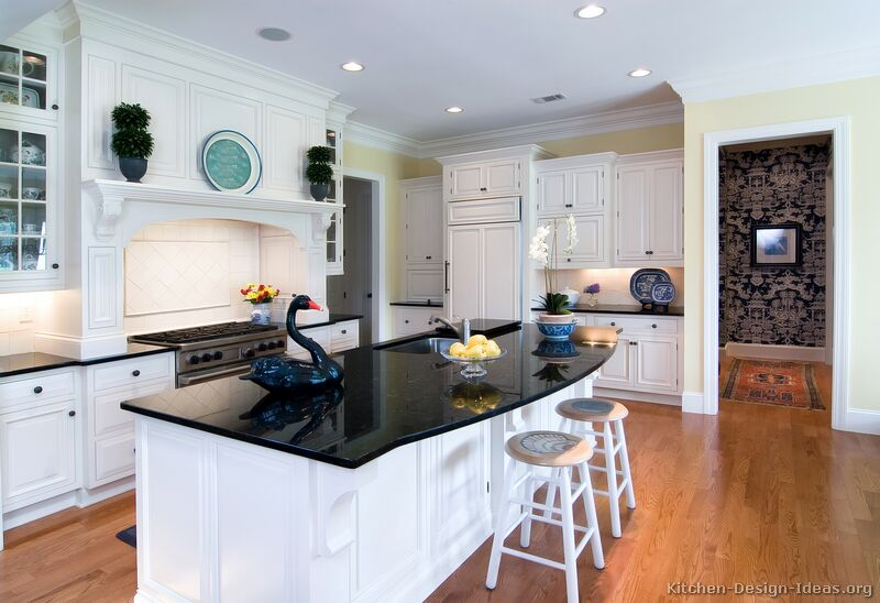 Traditional Kitchen with White Cabinets and Black Countertops