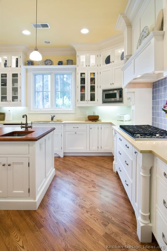 kitchens featuring white kitchen cabinets in traditional styles take