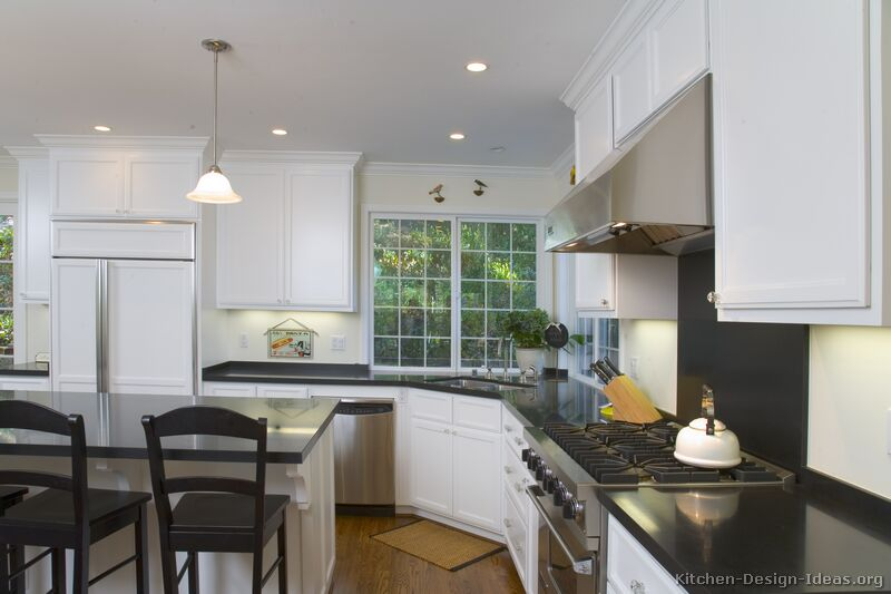 Pictures of kitchens traditional white kitchen for Kitchen designs with corner windows