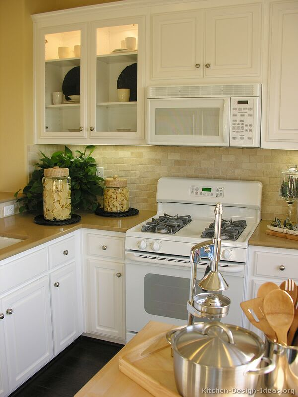 Pictures of kitchens traditional white kitchen for Kitchen designs with white appliances
