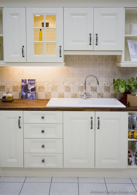 Pictures of kitchens traditional white kitchen for Kitchen cupboards designs for small kitchen