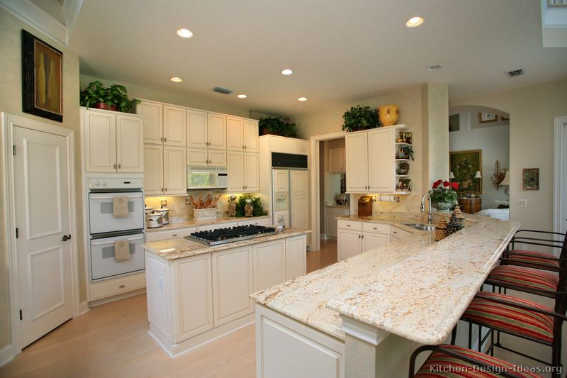 White granite countertop colors gallery for Traditional white kitchen cabinets