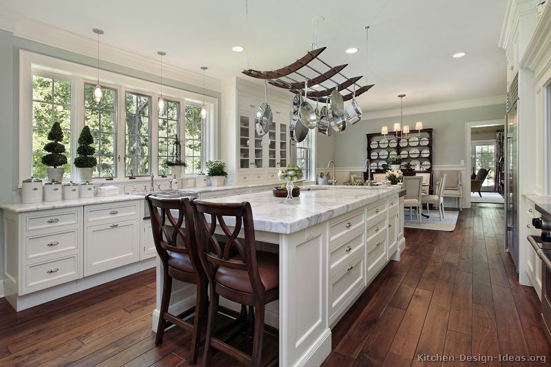 Early American Kitchens Pictures and Design Themes : kitchen cabinets traditional white 139 s49406986x2 luxury pot rack wood floor island seats from www.kitchen-design-ideas.org size 800 x 533 jpeg 77kB