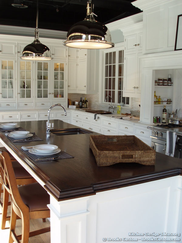 Traditional White Kitchen with a Walnut Island Countertop