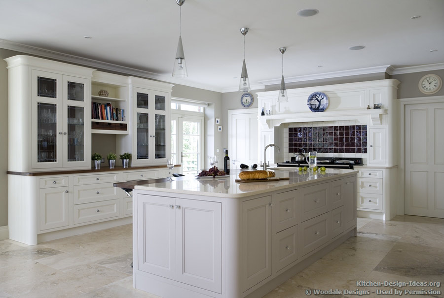 Curved cabinet ends and conical pendant lights give this kitchen a retro-classic ambiance