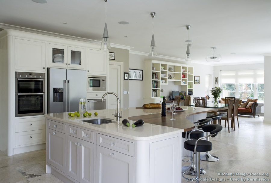 An Open-Plan Kitchen with a Piano-Shaped Island and Retro Bar Stools