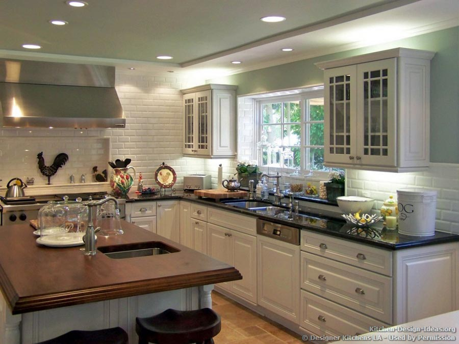 country kitchen with green walls wood island countertop subway tile